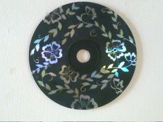paint a CD black then scrub the motive off