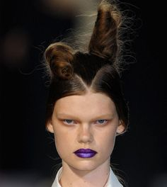 Yohji Yamamoto; her face/hair are the *definition* of severe, take-no-shit, ms. no-fun-and-games