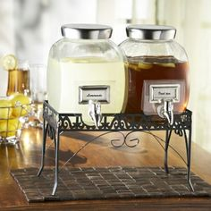 Shabby chic with a refined twist, these glass beverage dispensers double the deliciousness. With an intricate wrought iron stand to elevate for easy pouring, a plentiful two-gallon capacity, labels for enticing identification, and a heavy-duty abs spigot, these drink dispensers make serving simple.