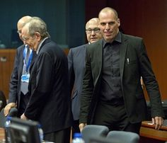 Greek Finance Minister Yanis Varoufakis, right, and French Finance Minister Michel Sapin, second right, arrive for a meeting of eurogroup finance ministers in Brussels on Saturday, June 27, 2015. Anxiety over Greece's future swelled on Saturday after Prime Minister Alexis Tsipras' call to have the people vote on a proposed bailout deal increased the risk that the country might fall out of the euro. (AP Photo/Virginia Mayo)
