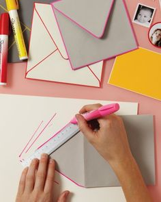 Customize stationery by edging cards and envelope flaps with poster paint markers, then decorate them with homemade stamps and medallion sti...