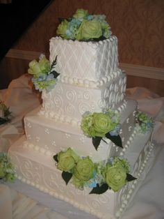 Your Reception at The Fez includes your cake by Wedding Cakes by Brenda McGee - Intricately Designed Square Cake with Floral Accents