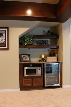 Basement kitchenettes are starting to gain popularity as more and more basements are turned into warm living areas. We are seeing many homeowners including a kitchenette or some type of beverage… Rustic Basement, Basement Ceiling, Basement Decor, Basement Gym, Family Room Design, Basement Remodeling, Home Remodeling, Basement Kitchenette