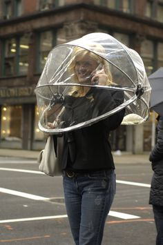 Nubrella Hands Free Umbrella, how crazy would you look walking down the street like this lol