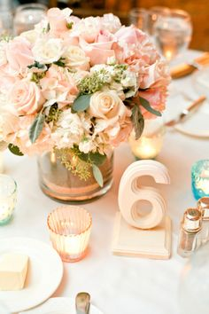 Blush Florals and White Painted Wooden Reception Table Numbers. So pretty.