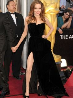 Angelina Jolie in a gorgeous velvet Atelier Versace gown with a thigh high slit.