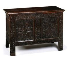 A CHARLES II OAK CHEST  LATE 17TH CENTURY, WEST COUNTRY  WITH PROFUSELY CARVED TWIN-PANEL FRONT WITH STYLISED FLOWER AND SCROLL DETAIL 29 IN. (74 CM.) HIGH; 42½ IN. (108 CM.) WIDE; 17½ IN. (44 CM.) DEEP