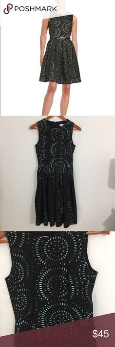 Calvin Klein fit and flare laser cut dress Amazing laser cut dress!  Turquoise underlay.  Missing belt but could easily be replace with a thin black belt or without!  Reasonable offers welcome.  No trades.  20% off 2 or more listings from my closet. Calvin Klein Dresses