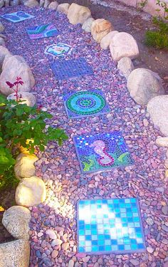 Mosaic Stepping Stone Pathway. Like the colored rocks against the blue stepping stones(Side Step House)