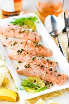 Poached salmon with capers and hollandaise sauce on a white platter Recipe For Poached Salmon, Lemon Salmon, Hollandaise Sauce, Salmon Fillets, Serving Platters, Salmon Recipes, Fresh Rolls, Rave, Stuffed Peppers
