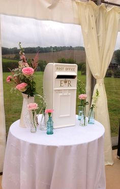 Postbox and vintage flowers In bottles