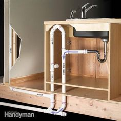 How to vent a kitchen island sink (and dishwasher too). Great site for DIYers