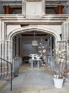 In the shop's entry, poured concrete floors pave the way to a grand greeting:a limestone arch salvaged from a manor house on the Potomac River.