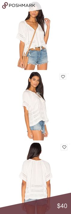 The Perfect White Summer Top This top is a crepe woven which features lace inset details, draw cord and tassels.  *100% Viscose Crepe  *Turn garment inside out before hand wash  *Hang to dry *Sold Out on Revolve Amuse Society Tops