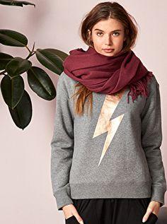 5049fd77626 A gorgeous sweat top with a striking contrast metallic lightning bolt logo.  Wear season after