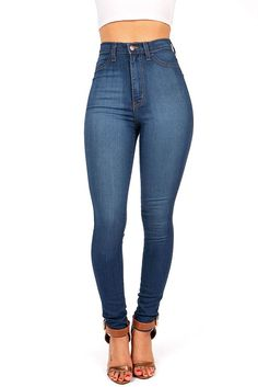 High waisted skinny jeans with a stretchy fit. Faux pockets at the front and open pockets at the back. Zip fly and button closure. *Machine Wash Cold *49% Siro Rayon 32% Cotton 17% Polyester 2% Spande