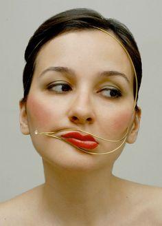 This is pretty weird jewelry, called Face distorting jewelry, designed by Burcu Büyükünal, photo by arthur hash.