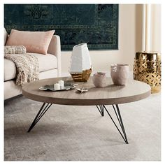 A top ski resort in the Italian alps inspired the modern rustic style of this contemporary coffee table. Designed for the cosmopolitan interior, its metallic angular base is expertly paired with a warm circular light grey top for timeless sophistication.
