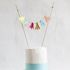 Make a super cute mini-tissue tassel garland cake topper for your next special cake! Our step by step tutorial makes it easy!