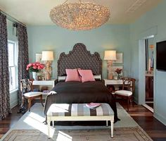 turquoise blue walls paint color, headboard, black bedding, pink pillows, white tables nightstands, chandelier, white gray turquoise blue striped bench, rug, white & black damask drapes, wood chairs and lamps.