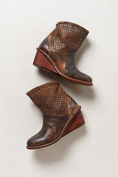 .Anthro. Perforated wedge booties http://www.anthropologie.com/anthro/product/shoes-boots/28748317.jsp?cm_mmc=CJ-_-Affiliates-_-rewardStyle-_-11292623_medium=rewardStyle_source=AFFILIATES_content=rewardStyle