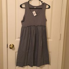 NWT J.Crew tank dress! This new j crew tank dress is slate gray and adorable! Never worn great for summer and very lightweight! Wrinkles from being packed other than that it is in new condition!! J. Crew Dresses Midi