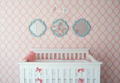 An amazing #stencil accent wall in this girly #nursery.  #accentwall #blueframes #coral