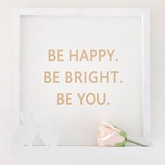 """""""Be happy. Be bright. Be you."""" Quote on bunny shelf"""