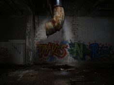 """This is an example of why some refer to urban blight as """"urban rot"""". Rotting pipes, crumbling walls, and decaying structures are all part of the blight taking place in urban America during the 1970's."""