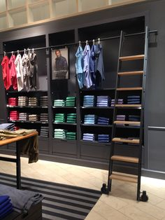 t-shirt wall concept - like that it is neat and colorized...even has the ladder we talked about