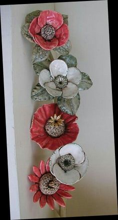 This flower is a one of a kind handmade stoneware wall hanging i currently have 5 in different sizes ranging from 7 to 10 in size they look great as a group or individually as a statement the one in this listing is approx 7 it is wired for hanging Ceramic Poppies, Ceramic Flower Pots, Diy Clay, Clay Crafts, Diy And Crafts, Ceramic Pottery, Pottery Art, Ceramic Art, Clay Wall Art