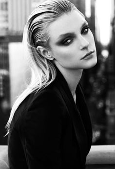 Ultimate Fashion slicked back straight, blonde hair extreme black smokey eye makeup