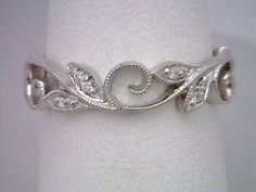 i love this one too  http://www.jedwardsdiamonds.com/item/14k-white-gold-diamond-leaf-stackable-ring-10-carat-total-weight