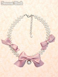 this would be so easy to make. I have seen a necklace that looks exactly like the on e here only sans bow and large pearl all i would have to do is get a large pearl and three grosgrain bows and sew them to the necklace and I will have a real pearl version for cheaper!