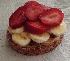 Quick & Easy Healthy Breakfast On-The-Go!Made with Quakers Chocolate Rice Cake, Peanut-Butter, Ripe Banana and Fresh Strawberry slices.
