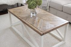 A coffee table with a modern farmhouse design and wood inlay top in a herringbone pattern. Also how to achieve this aged warm wood finish on the table top.