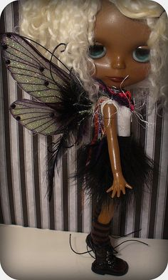 Fairy ~ What a unique little fairy  Modern fairy boots and all  Love those wings and hair color and all.