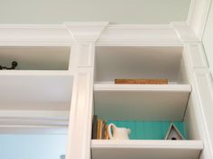 Blog Cabin 2013: Landing Pictures: Decorative pilasters and crown molding offer a finishing touch in keeping with the home's classic Southern cottage style. From DIYnetwork.com