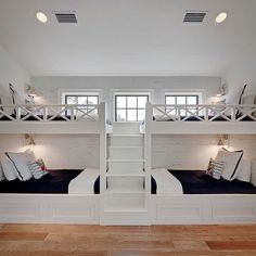 The Chic Technique: Bunk Room. White bunk bed with navy bedding. bunk room features two sets of white built-in bunk beds dressed in navy bedding lined with distressed shiplap flanked by a built-in staircase. Old Seagrove Homes. Bunk Bed Rooms, Bunk Beds Built In, Bunk Bed Wall, Twin Beds, Double Bunk Beds, Build In Bunk Beds, Wall Beds, Fun Bunk Beds, Boys Bunk Bed Room Ideas