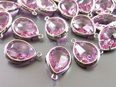 Hey, I found this really awesome Etsy listing at https://www.etsy.com/listing/197180900/2-pink-glass-stone-charms-with-silver