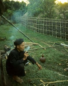 A Hmong farmer in the Golden Triangle area of Thailand enjoys some tobacco in the early morning before he goes out to his fields. Photo from my book #VanishingAsia #hmong #Thailand
