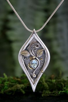 Venus, Aquamarine Gold and Silver Pendant. || Wish the 3 vines in the center were done in gold, and the bezel, too. A