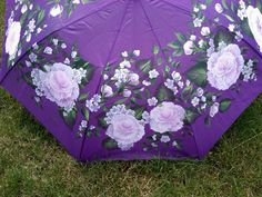 Just because it's a rainy day, doesn't mean you have to carry a dull umbrella! Pink roses and delicate buds look for the taste of a gentle Spring rain on this large, hand-painted umbrella - $45