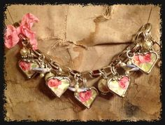 Beautiful heart broken china jewelry bracelet with bluebird beads. $158.00, via Etsy.