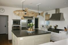 Love the island and the cooktop!  The giant fish... not my style.