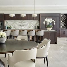 "Kim Harvey on Instagram: ""Classic contemporary kitchen in one of our Surrey projects. Bespoke starburst top dining table with brass metal detailing ties in with our…"" Luxury Home Decor, Luxury Interior Design, Bloomfield Homes, Kitchen Decor, Kitchen Design, Dining Table Design, Elegant Dining, Luxury Kitchens, Traditional House"