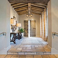 Home entryway with exposed timber beams and tiled floors