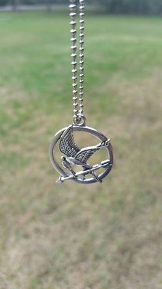 Hunger Games Necklace/Hunger Games by TSWreathsandMore on Etsy