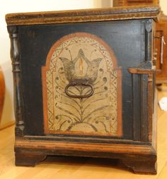 """Pook & Pook. April 25th & 26th 2014. Lot 751 end detail. Berks County, PA. painted pine dower chest, dated 1776, decorated by the Black Unicorn Artist, the façade with 3 arched panels & potted tulips, with a central panel of a soldier on horseback, 22 1/2"""" h., 44 1/2"""" w. Estimated: $10K - $15K."""