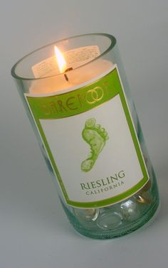 Recycled Wine Bottle Candle, would be cute to do with the wine bottles from the wedding, with the date and everything monogrammed on the other side :)